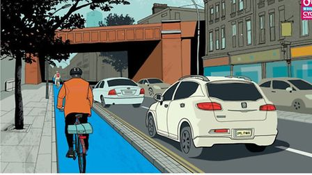 An artist's impression of the Cycle Superhighway from Bow to Stratford which will have a raised curb