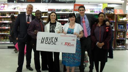 Stratford Sainsbury's store manager Mark Twell hands over a £500 cheque to Haven House Children's Ho