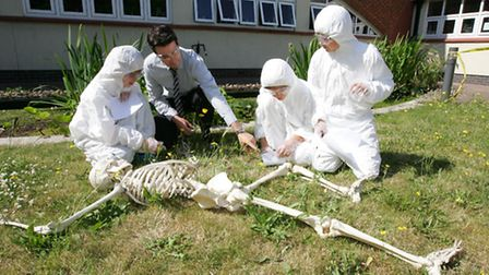 Year 7 students at Sanders Draper School, in Hornchurch, are studying forensic science. Pictured are