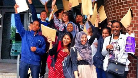 Students overjoyed at their GCSE results on the steps of Forest Gate Community School.