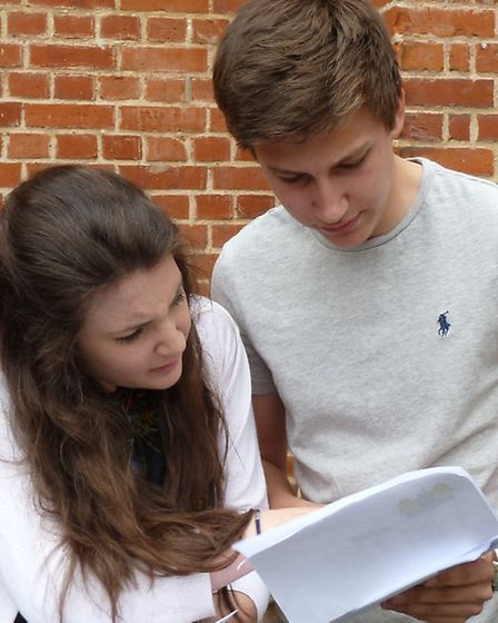 May El-Shawk and Etienne Caswell confer over their grades