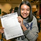 Zena Sheikh with her results at Oaks Park High
