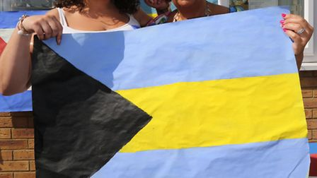 Manager Rachel Kayler and owner Maryanne Kayler with the Bahamian flag