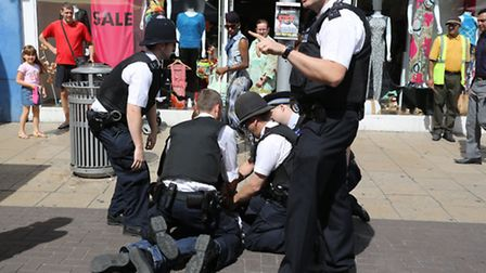 Redbridge Police inIlford high street on an anti-social operation Police detaining a man after