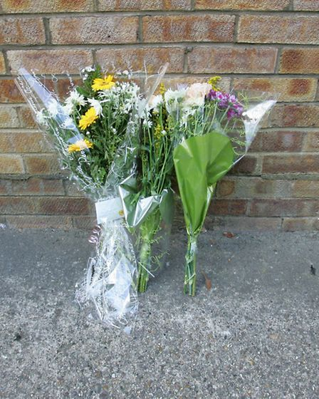The floral tributes outside Hurst court in Woodford
