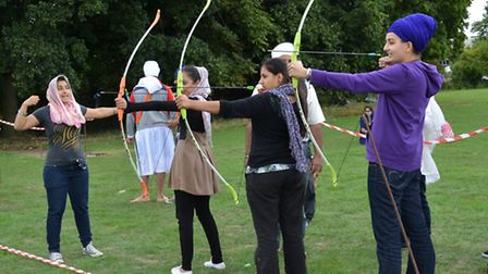 Children playing archery at the camp