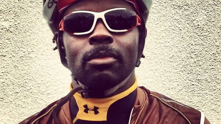 Silvertown firefighter Andrew Frimpong in full cycle gear.