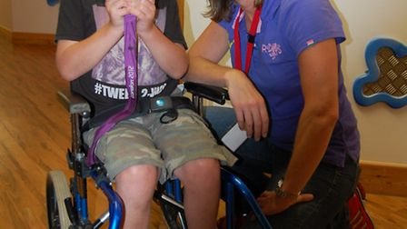Katherine Grainger shows Rory Baker her Olympic gold at the hospice