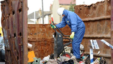 Demolition worker empties rubbish from the house