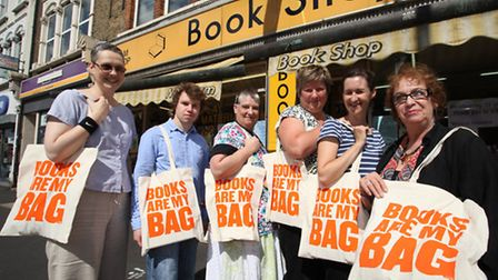 Newham Bookshop manager Vivian Archer, right, and customers promote the reading campaign Books are m