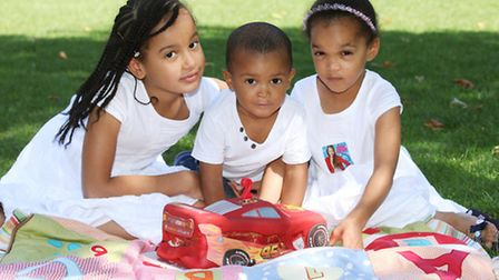 Zikora Wright celebrates his second birthday with sisters Ona, left, and Dili.