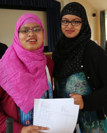 Twins Shaira and Raisa Hassan (in pink) both got into their university choices