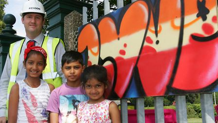 Phil Raven, Hannah Chaudhry, Shivam Subudhi and Naomi Chaudhry with the art work