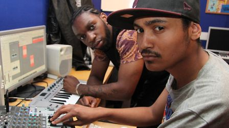 Troy Prince learning music production at the radio studio from mentor Jonathan Mensah
