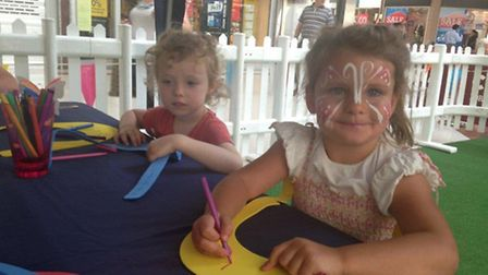 Face-painted children getting stuck into arts and crafts in the Parklife attraction at the Stratford
