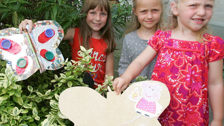 Maddie, Grace and Sylvie Simmons with their recycled butterflies