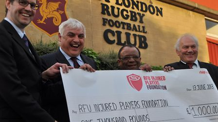 Ian Jenkinson from the RFU, left, receives the cheque from Jeff Probyn, right, with Nick Bracken, se