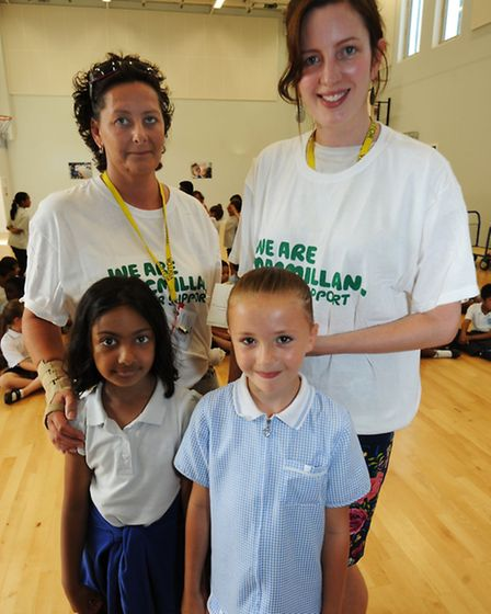 Back row left to right: mother Lisa Kirk and Alex Barlow from Macmillan Cancer Care. Front row left