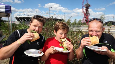 Ian,left, Ryley and Ray Hagger tuck in a babecue free hamburger at the fun day organised by Communit