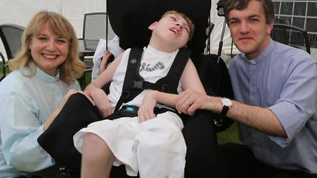Rev Annie McTighe and Rev Paul Harcourt with one of the hospice's patients.