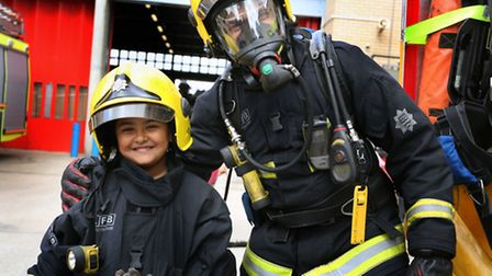 Fire Awareness day at Ilford Fire Station A fireman with Zayd 5