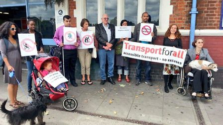 Protest group Transport For All outside Manor Park station.