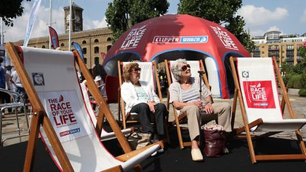 Visitors relax in the deck chairs watching a video of the Round the World Yacht Race at St Katharine