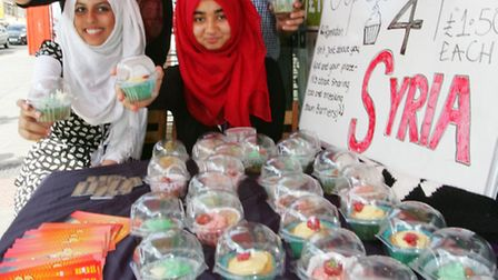 Khadija Begum, Sara Qureshi, Mariam Mahmood and Kahear Khan selling their cupcakes in aid of Syria