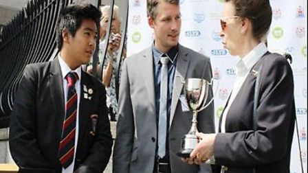 Mr Cherrett and Captain Julius Casela about to receive the trophy from HRH Princess Anne.