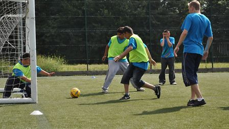 Youngsters playing football at the WHCST pitch in Beckton.