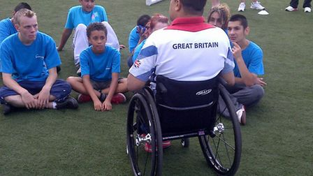 Paralympics GB wheelchair rugby player Bulbul Hussain talking to the young sportsmen.