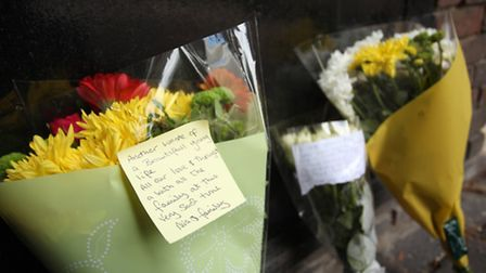 Floral tributes are laid at the spot where 16-year-old Ajmol Alom was stabbed to death on Monday nig