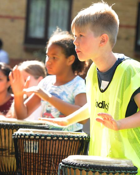 Lesley Walls Pue (yellow top) and friends try drumming