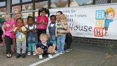 Lisa Davy and Vicky Palmer with kids outside the nursery