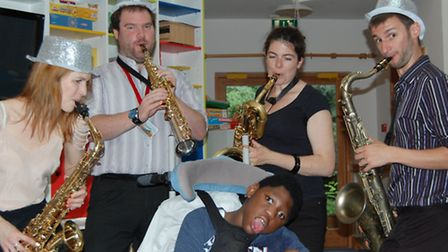 City Bells perform for youngster at Richard House Children's Hospice.