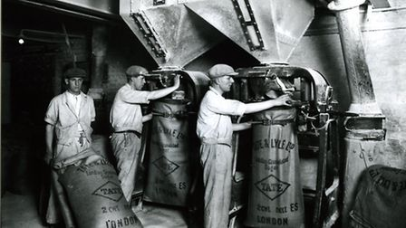 Workers at Tate&Lyle when the sugar used to go into sacks