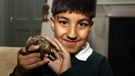 Ahad Ali 9 named his tortoise Tashi which is a tibettan name meaning Lucky