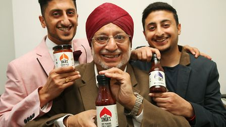 Father Hardev Singh with Kuldip, left, and other son Sukhi show off their Mr Singh's spicy sauces.