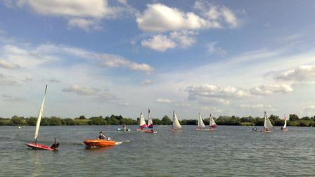 SERIES OF 4 PICTURES. Water activities at Fairlop Waters Lake - sailing on Dinghies. Sometimes, when
