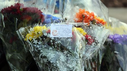 """Flowers on Champion's grave included a handwritten note saying: """"Still missin you every single day."""