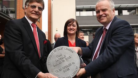 Lord Noor, Cathy Walsh and Professor John Joughin hold a time capsule at the launch of the new Strat