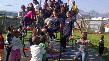 From left: Aneeka and Sarika with the youngsters in Cape Town