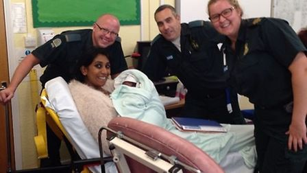 Diane Krish-Veeramany with baby Jonah and paramedics after giving birth at Manford Primary School.