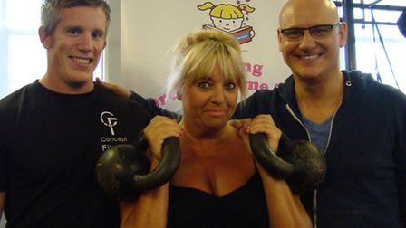 Dream Factory founder Avril Mills training for the Arctic trek with Brett Sizeland (left) and comedi