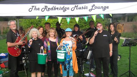 Redbridge Music Lounge performers and members with their donation buckets