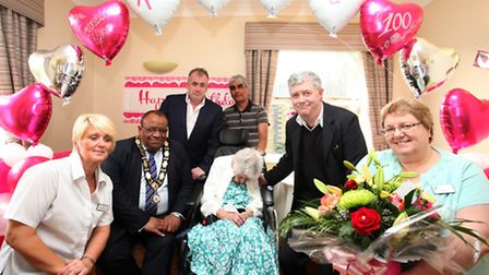 Nora Vick, centre, celebrates her 100th birthday with friends and staff from the Bakers Court.