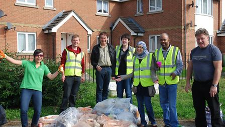 Residents and councillors with the bags of rubbish they collected