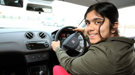 Shaan Johal, 11, puts her hands on the wheel for the first time