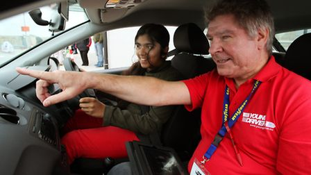 Shaan Johal, 11, follows the instructions from Tim Bentley as she drives at the launch of the Young
