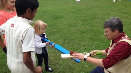 Children learn the basics of cricket at the fun day on Oakfield playing fields
